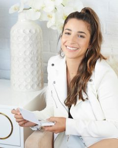 Aly Raisman proudly holding an eyeshadow palette from her new Fierce makeup collection with LimeLife by Alcone, Aly Raisman, Fierce Collection, LimeLife by Alcone, #livebrazenlybeautiful, Jean, brazenfaithllc.com, #brazenfaithllc, Founding International Beauty Guide